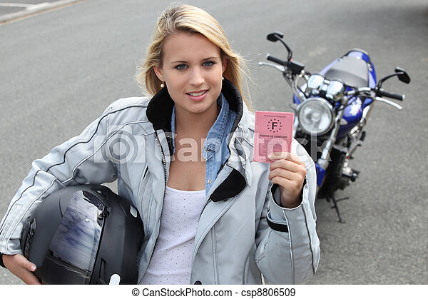 Young woman with motorcycle and French license - csp8806509