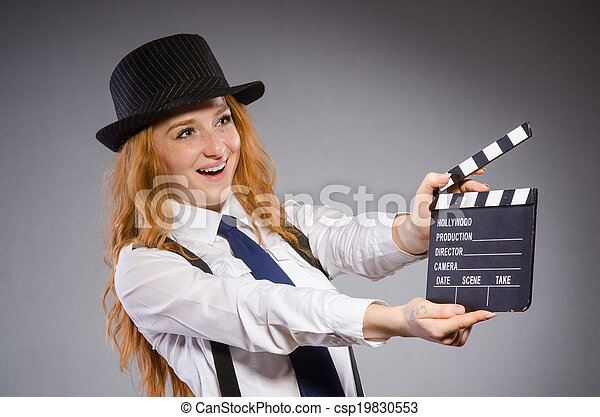 Young woman with movie board - csp19830553