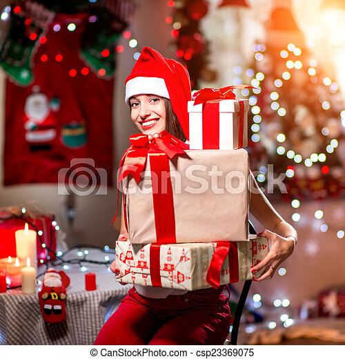 Young woman with present box on Christmas - csp23369075