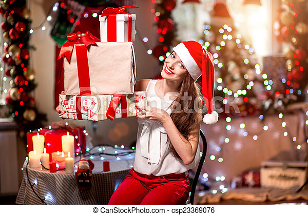 Young woman with present box on Christmas - csp23369076