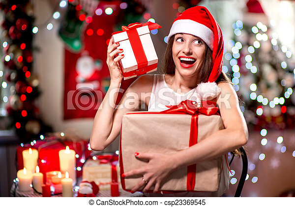 Young woman with present box on Christmas - csp23369545