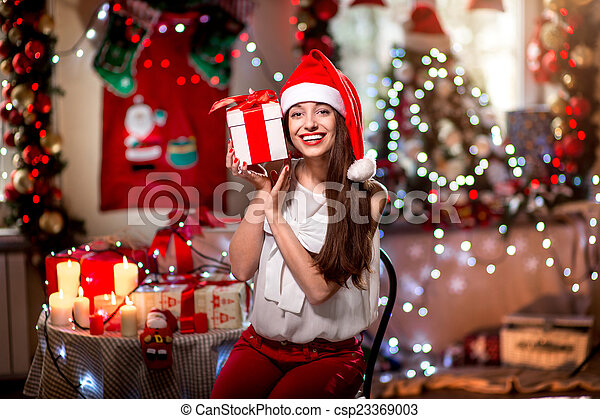 Young woman with present box on Christmas - csp23369003