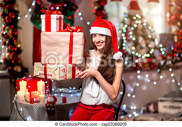 Young woman with present box on Christmas - csp23369205