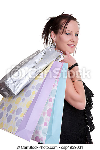 young woman with shopping bags on white - csp4939031