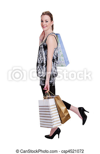 young woman with shopping bags on white - csp4521072