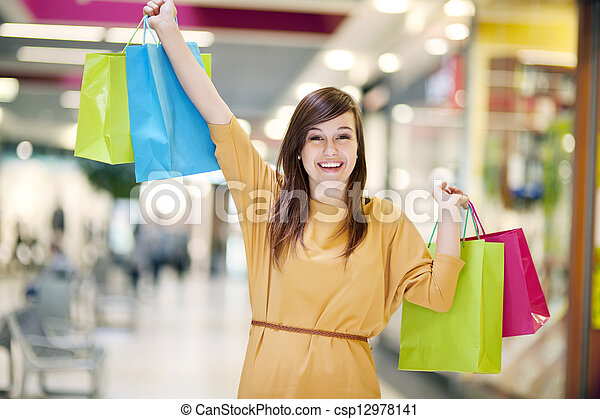Young woman with shopping bags - csp12978141