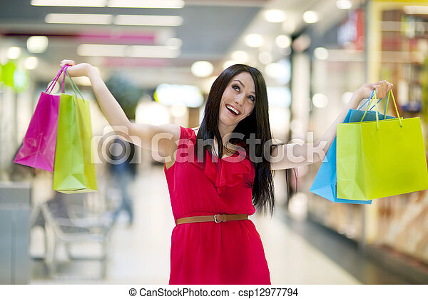 Young woman with shopping bags - csp12977794