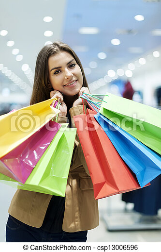 Young woman with shopping bags - csp13006596