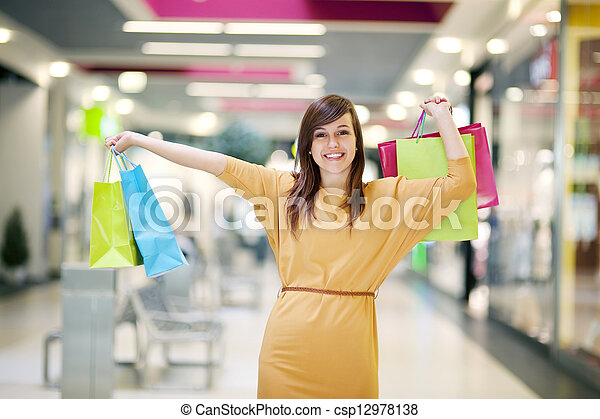 Young woman with shopping bags - csp12978138