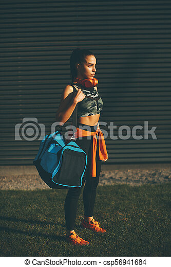 Young woman with sport bag outdoor - csp56941684
