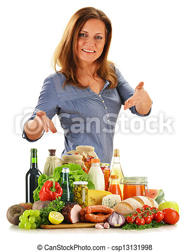 Young woman with variety of grocery products isolated on white - csp13131998