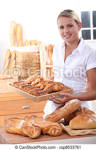Young woman working in a bakery - csp8533761
