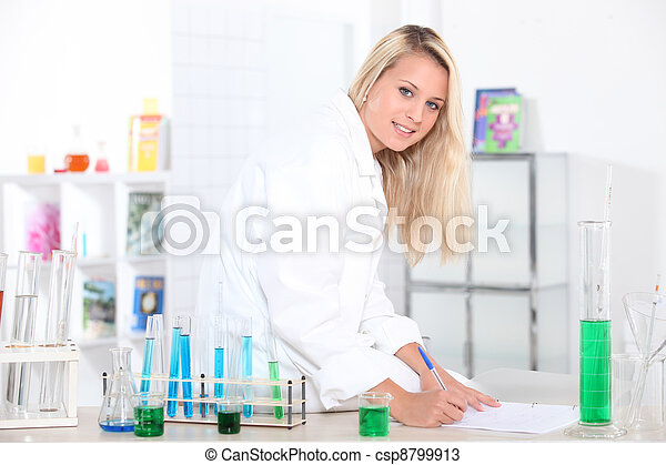 Young woman working in a laboratory. - csp8799913