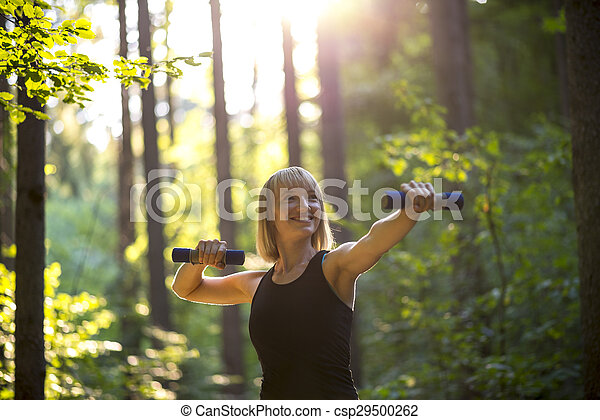 Young woman working out with weights - csp29500262