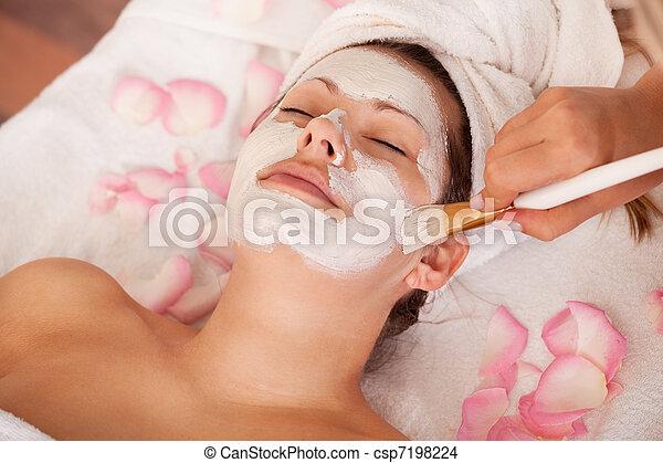 Young women getting facial mask - csp7198224