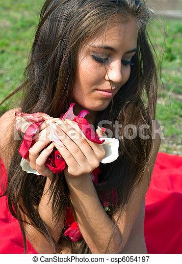 young women holding petals - csp6054197