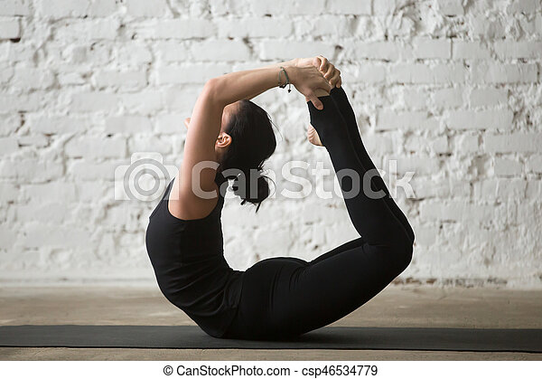 young yogi attractive woman in bow pose white loft