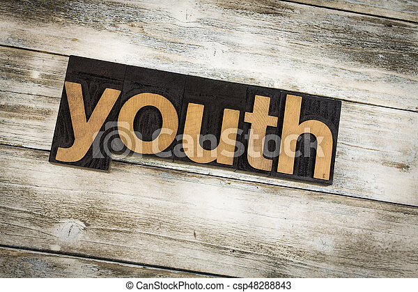 Youth Letterpress Word on Wooden Background - csp48288843