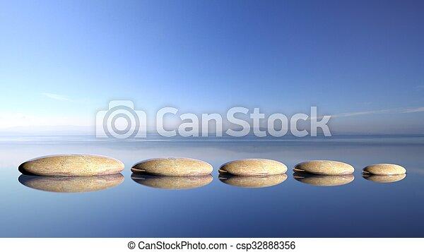 Las piedras Zen reman de grandes a pequeñas en agua con cielo azul y paisajes pacíficos. - csp32888356