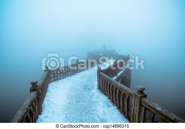 zigzag bridge in winter fog - csp14896315