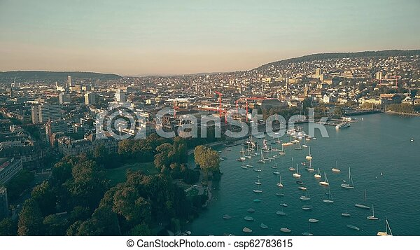 Zurich cityscape and the Limmat river outflow, aerial view - csp62783615