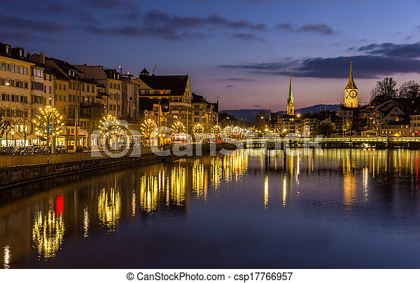 Zurich on banks of Limmat river at winter evening - csp17766957
